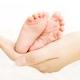 Baby legs in mothers hands 16126665